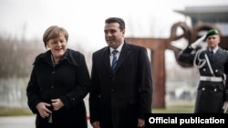 Macedonian Prime Minister Zoran Zaev (right) is welcomed to Berlin by German Chancellor Angela Merkel on February 21.