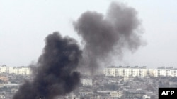 Smoke billows from a targeted location inside the northern Gaza Strip.