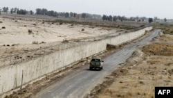 A military vehicle patrols in southeastern Iran next to the country's border with Afghanistan.