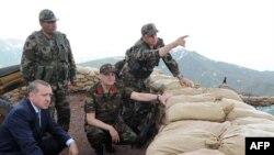 Целью заговора было отстранение от власти партии Эрдогана (на фото слева) и введение военного положения в Турции