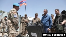 Afghanistan -- Armenia's Defense Minister Seyran Ohanian inspects Armenian troops near Kunduz, 24Jul2010.
