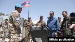 Afghanistan -- Armenia's Defense Minister Seyran Ohanian inspects Armenian troops near Kunduz, 24July 2010.