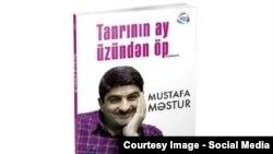 """Mustafa Məsturun """"Tanrının ay üzündən öp"""" romanının üz qabığı."""