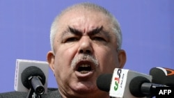 Afghanistan -- Afghan vice-presidential candidate Abdul Rahid Dostum, who is campaigning with presidential candidate Ashraf Ghani Ahmadzai, addresses the crowd during a gathering in the outskirts of Kunduz province, March 19, 2014