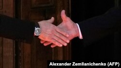 Russian President Vladimir Putin (left) shakes hands with U.S. President Joe Biden during their meeting in Geneva on June 16.