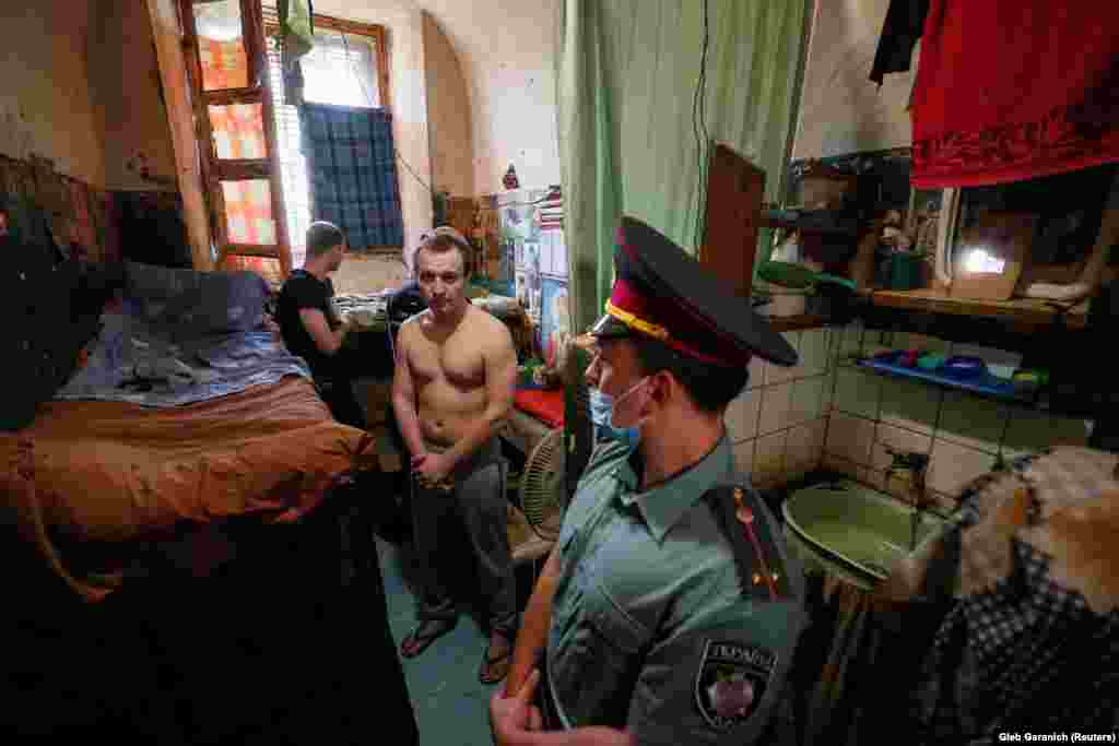 Detainees are seen in an old cell in a pretrial detention facility in Kyiv. (Reuters/Gleb Garanich)
