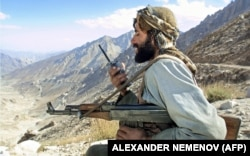 A Taliban fighter from Tajikistan guards a position in northern Afghanistan.