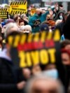 BOSNIA-HERZEGOVINA -- People display signs during a protest urging the government to obtain coronavirus disease (COVID-19) vaccines, in Sarajevo, April 6, 2021
