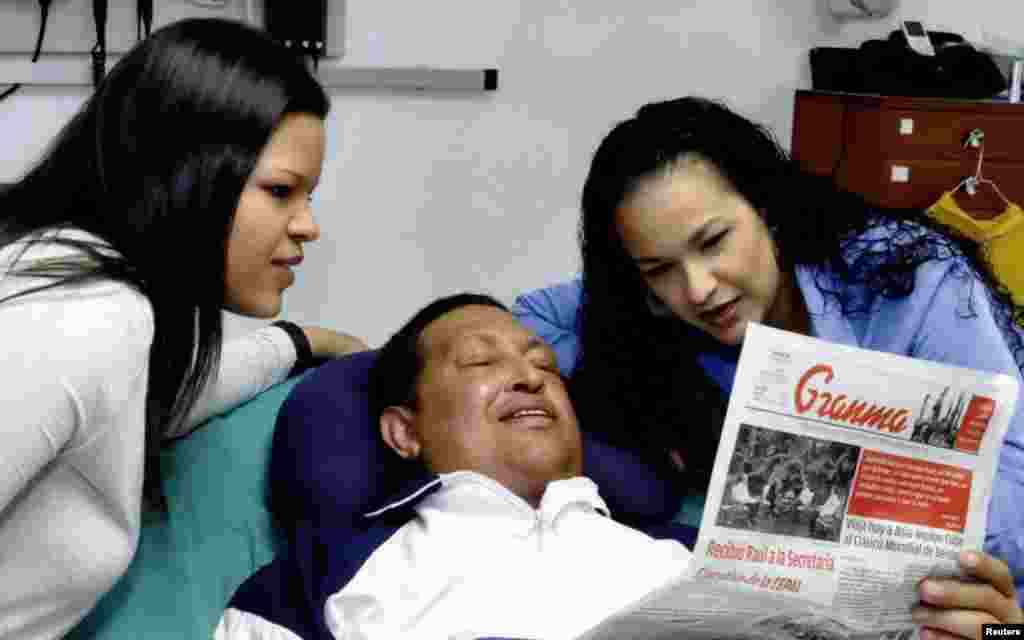Chavez with his daughters Rosa (right) and Maria while recovering from cancer surgery in Havana in a photo dated February 15, 2013.