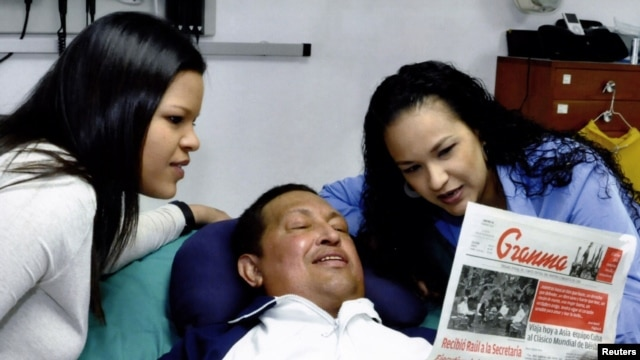 Venezuela's President Hugo Chavez is seen with his daughters, Rosa Virginia (right) and Maria, in a photo released by the government -- the only public images of the president in two months.