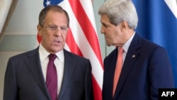 U.S. Secretary of State John Kerry (right) speaks with Russian Foreign Minister Sergei Lavrov during a meeting in Paris on October 14.
