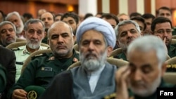 IRGC intelligence chief Hossein Taeb (C) with Qassem Soleimani (R), October 3, 2019