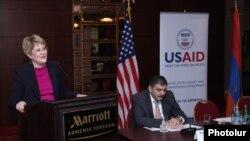 Armenia -- The USAID mission director for Armenia, Karen Hilliard, presents the agency's 5-year aid strategy, Yerevan, 11Dec2013.