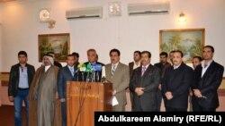 أعضاء حركة الوفاق الوطني العراقي في البصرة يعلنون إنسحابهم في مؤتمر صحفي.