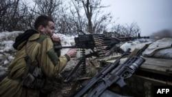 A pro-Russia separatist fires his machine gun toward Ukrainian Army positions near Debaltseve in late January 2015.