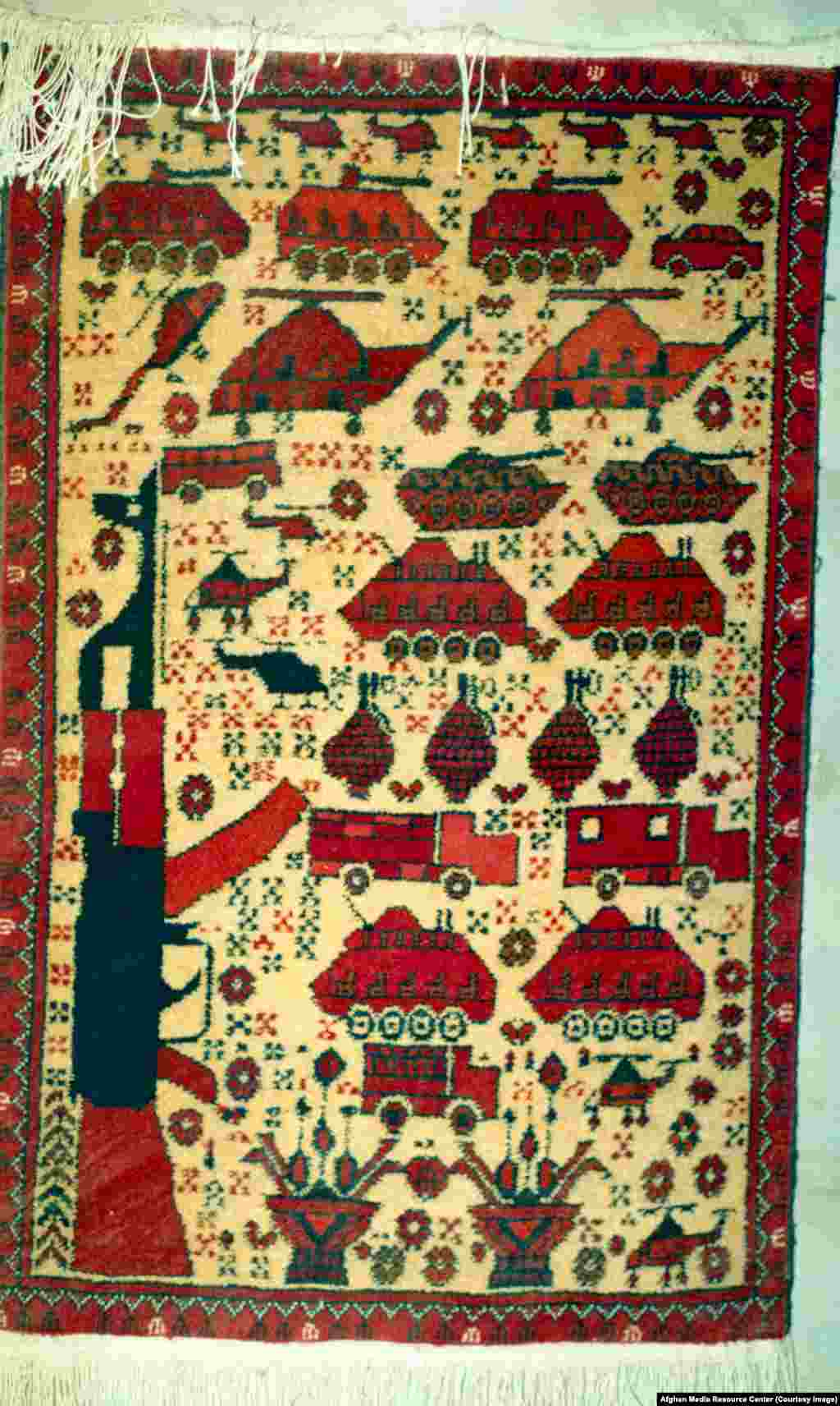 Soviet weaponry depicted on a carpet woven by Afghan refugees.