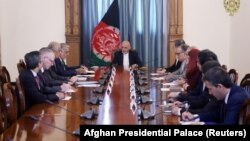 Afghan President Ashraf Ghani (center) meets with U.S. special representative for Afghanistan Zalmay Khalilzad (3rd left) in Kabul on September 2.