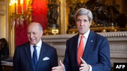 France -- US Secretary of State John Kerry (R) talks with French Foreign Minister Laurent Fabius prior to their meeting at the French Foreign ministry, Quai d'Orsay, in Paris on January 13, 2014.