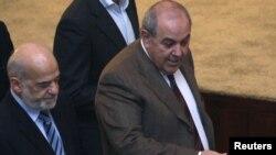 زعيم إئتلاف العراقية أياد علاوي ورئيس التحالف الوطني العراقي إبراهيم الجعفري في طريقهما الى جلسة لمجلس النواب