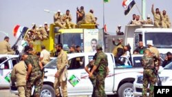 متطوعون في قوات الحشد الشعبي ببغداد