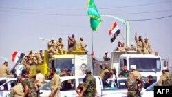 جنود ومتطوعون عراقيون يصلون إلى مدينة سامراء - 2 تموز 2014
