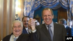 Міністр закордонних справ Сирії Валід аль-Муаллем (Л) та Росії Сергій Лавров (П)