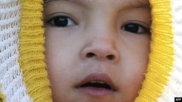 A child wrapped up against the cold in Ashgabat.