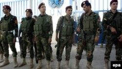 Күрт аскерлери Эрбилдеги БУУ үйүн кайтарууда. 4-август.