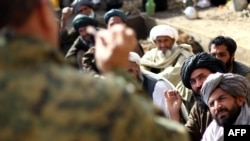 An Afghan army commander addresses tribal chiefs in Helmand Province on February 26.