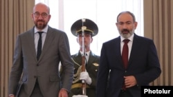 Armenia - Armenian Prime Minister Nikol Pashinian and European Council President Charles Michel arrive for a news conference after holding talks in Yerevan, July 17, 2021.
