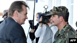 Haris Silajdzic (left), a member of Bosnia's tripartite presidency, arrives at EUFOR headquarters in Butmir on October 9.