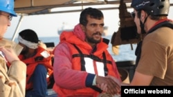 """A U.S. Defense Department photo of an Iranian sailor from the """"Ya Hussayn,"""" which the U.S. said was assisted in the northern Persian Gulf by the U.S. Fifth Fleet's cutter """"Monomoy"""" on January 10 after a distress call."""