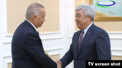 Uzbek President Islam Karimov's (left) meeting with visiting Kazakh Foreign Minister Yerlan Idrisov in Tashkent was shown on state television.