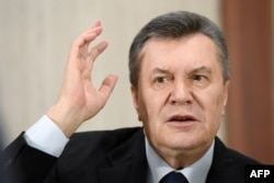 Former Ukrainian President Viktor Yanukovych answers journalists' questions during a press conference in Moscow on February 21.