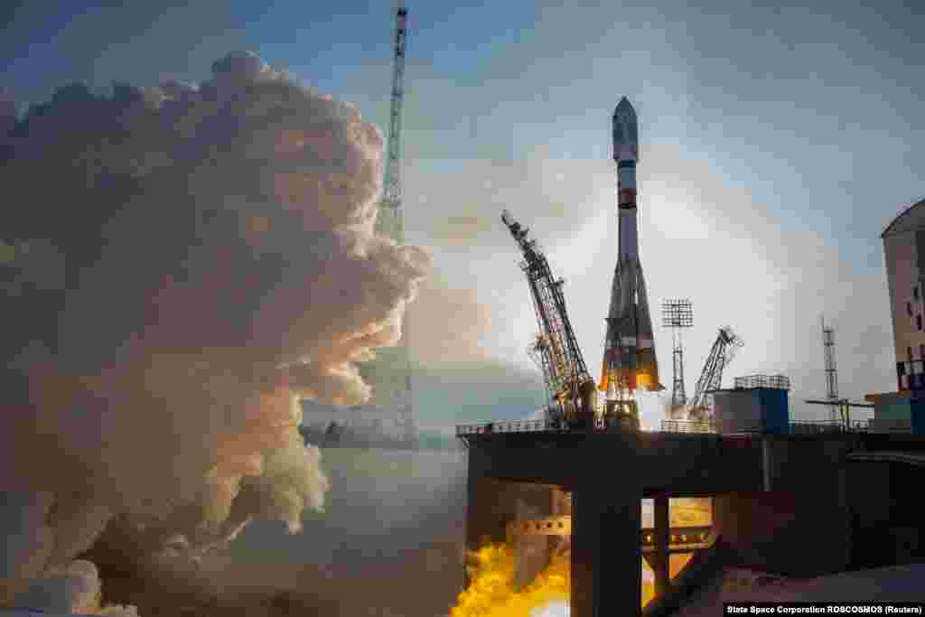 A Soyuz spacecraft carrying the Canopus satellite blasts off from the launchpad at the Vostochny Cosmodrome in Russia on December 27. (Roskosmos via Reuters)