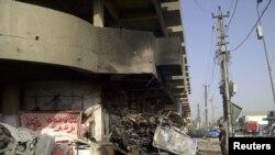 На місці одного з вибухів у Багдаді 13 червня 2012 року