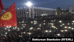 Supporters of opposition parties rally against the election results in Bishkek on October 5.