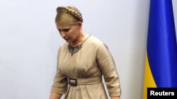 Prime Minister Yulia Tymoshenko leaves after a news conference in Kyiv today