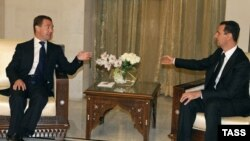 Syrian President Bashar al-Assad (right) meets with his Russian counterpart Dmitry Medvedev in Damascus on May 10.