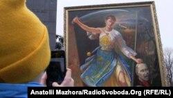 Картина харківського художника Іллі Паньока, на якій зображена Надія Савченко і Володимир Путін, під час акції на підтримку української льотчиці, Харків, 6 березня 2016 року