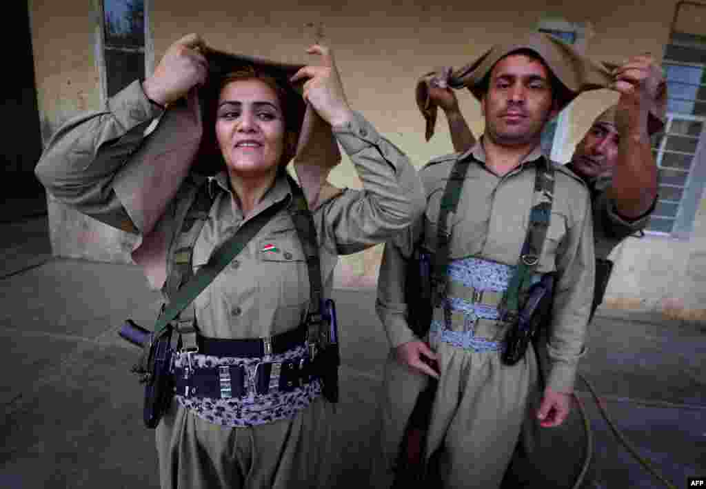 Iranian Kurdish Peshmerga members prepare for military exercises in Koya, 100 kilometers north of Irbil, Iraq. (AFP/Safin Hamed)