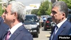 Armenia - President Serzh Sarkisian (L) and his chief bodyguard Vachagan Ghazarian, 11 July 2015.