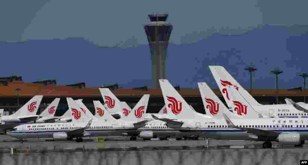 Аэропорт Пекина, Китай. 26 марта 2020 года