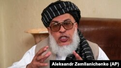 Sher Mohammad Abbas Stanikzai, the Taliban's chief negotiator, speaks to reporters after talks in Moscow in May.