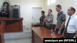 Nagorno-Karabakh - Manvel Hazroyan (second from right) is sentenced to life in prison for killing four fellow soldiers and wounding three others in November 2010, 03Aug2011.