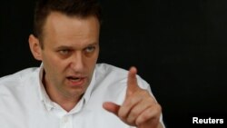 Russia -- Russian opposition leader Aleksei Navalny speaks during an interview with Reuters in Moscow, July 12, 2017