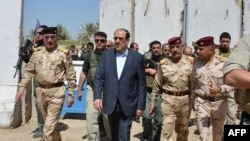Iraqi Prime Minister Nuri al-Maliki tours military posts on the outskirts of Baghdad on August 6. Can Maliki rise above sectarian divisions to finally unite Iraq?