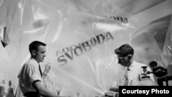 Two RFE/RL employees prepare balloons which will carry leaflets into Czechoslovakia. (1951)