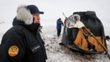Roskosmos chief Dmitry Rogozin stands near a Soyuz capsule shortly after its landing in a remote area near the Kazakh town of Zhezkazgan in December 2018.