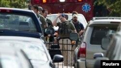Полиция кызматкерлери атышуудан кийин, Вашингтон, 16-сентябрь, 2013.